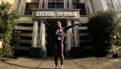 Excited female apprentice outside of BBC Bristol